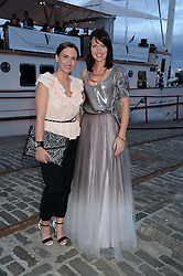 Johnnie Walker Gold Label Reserve Finale Celebration Party aboard the John Walker & Sons Voyager moored at the Prince of Wales Docks, Leith, Edinburgh, Scotland on 14th August 2013.<br /> Picture shows:-Left to right, sisters Karla Andrews and Kassie Andrews.