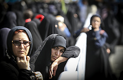 TEHRAN, Oct. 4, 2015 (Xinhua) -- Iranian women mourn during a funeral ceremony in downtown Tehran, Iran, on Oct. 4, 2015. Thousands of Iranians held ceremonies on Sunday to mourn their pilgrims who died in the latest Hajj stampede in Saudi Arabia on Sept. 24. The ceremonies were held in the capital, Tehran, and Iran's other cities to see off the dead bodies of 104 Iranian pilgrims that were transferred to Tehran on Saturday. . (Xinhua/Ahmad Halabisaz)(cl) (Credit Image: © Ahmad Halabisaz/Xinhua via ZUMA Wire)