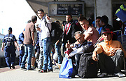 Migrants wait on a train to take them to Germany or Austria at the train station in Győr close to the border of Hungary and Austria, September 6 2015.  Hundreds of migrants have resumed their journey through Austria to Germany after Hungary's decision on Friday to let them through.