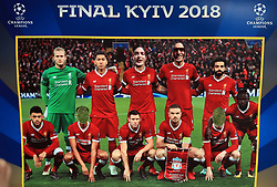 Fans pose with a cardboard cutout of the Liverpool team in Kiev where Liverpool will play Real Madrid in the UEFA Champions League Final tomorrow night.