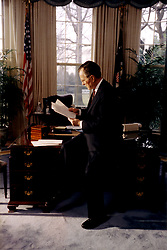March 2, 1992 - Washington, District of Columbia, United States of America - Washington, DC - March 2, 1992 -- United States President George H.W. Bush at work in the Oval Office at the White House in Washington, DC on March 2, 1992. .Mandatory Credit: David Valdez / WH via CNP (Credit Image: © David Valdez/CNP/ZUMAPRESS.com)