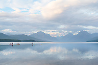 Kayakers and paddle boarding on Lake McDonald Glacier National Park