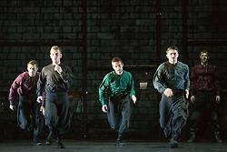"© Licensed to London News Pictures. 14/01/2015. London, England. Dress rehearsal of ""Young Men"" by BalletBoyz the Talent. ""Young Men"" is a brand new work from BalletBoyz which premieres at Sadler's Wells on 14 January 2015 and simulaneously opens Sadler's 2015 programme. ""Young Men"" is a moving portrayal of love, friendship, losss and survival and explores the theme of war and the bonds that develop between the young men who are utterly consumed by it. Produced by BalletBoyz artistic director Michael Nunn and William Trevitt, choreography by Ivan Perez, newly commissioned score by Keaton Henson which is performed live onstage by a 12-strong band of musicians. Dancers: Andrea Carrucciu, Dalma Doman, Simone Donati, Flavien Esmieu, Marc Galvez, Adam Kirkham, Edward Pearce, Leon Poulton, Matthew Rees, Matthew Sandiford, Bradley Waller and Jennifer White. Photo credit: Bettina Strenske/LNP"