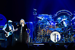 © Licensed to London News Pictures. 24/09/2013. London, UK.   Fleetwood Mac performing live at The O2 Arena.  In this pic - John McVie  (left), Stevie Nicks (centre), Mick Fleetwood (right). Fleetwood Mac are a British-American rock band formed in 1967 in London consisting of Mick Fleetwood (drums), John McVie (bass), Lindsey Buckingham (guitar/vocals) and Stevie Nicks (vocals).  Photo credit : Richard Isaac/LNP