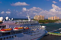 Carnival Fantasy cruise ship with the Atlantis Paradise Island resort in background, Nassau, The Bahamas