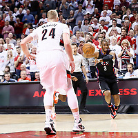 25 April 2016: Los Angeles Clippers guard Chris Paul (3) passes the ball past Portland Trail Blazers center Mason Plumlee (24) during the Portland Trail Blazers 98-84 victory over the Los Angeles Clippers, during Game Four of the Western Conference Quarterfinals of the NBA Playoffs at the Moda Center, Portland, Oregon, USA.