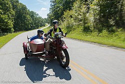 Gary Wright riding his 1930 Indian Chief with his wife Linda Bendorf in the sidecar during Stage 5 of the Motorcycle Cannonball Cross-Country Endurance Run, which on this day ran from Clarksville, TN to Cape Girardeau, MO., USA. Tuesday, September 9, 2014.  Photography ©2014 Michael Lichter.