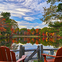 Found this idyllic and scenic New England fall foliage spot at the Kingsbury Pond in Medfield, Massachusetts. The New England fall foliage beautifully complimented the red lawn chairs. <br /> <br /> Kingsbury Pond photography images are available as museum quality photo, canvas, acrylic, wood or metal prints. Wall art prints may be framed and matted to the individual liking and interior design decoration needs:<br /> <br /> https://juergen-roth.pixels.com/featured/kingsbury-pond-in-medfield-massachusetts-juergen-roth.html<br /> <br /> Good light and happy photo making!<br /> <br /> My best,<br /> <br /> Juergen<br /> Licensing: http://www.rothgalleries.com<br /> Photo Prints: http://fineartamerica.com/profiles/juergen-roth.html<br /> Photo Blog: http://whereintheworldisjuergen.blogspot.com<br /> Instagram: https://www.instagram.com/rothgalleries<br /> Twitter: https://twitter.com/naturefineart<br /> Facebook: https://www.facebook.com/naturefineart