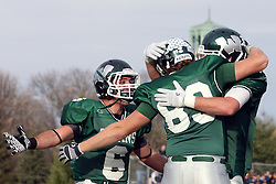 12 November 2011:  Cameron Blossom celebrates in the end zone with Joe Musso and another team mate during an NCAA division 3 football game between the Augustana Vikings and the Illinois Wesleyan Titans in Tucci Stadium on Wilder Field, Bloomington IL