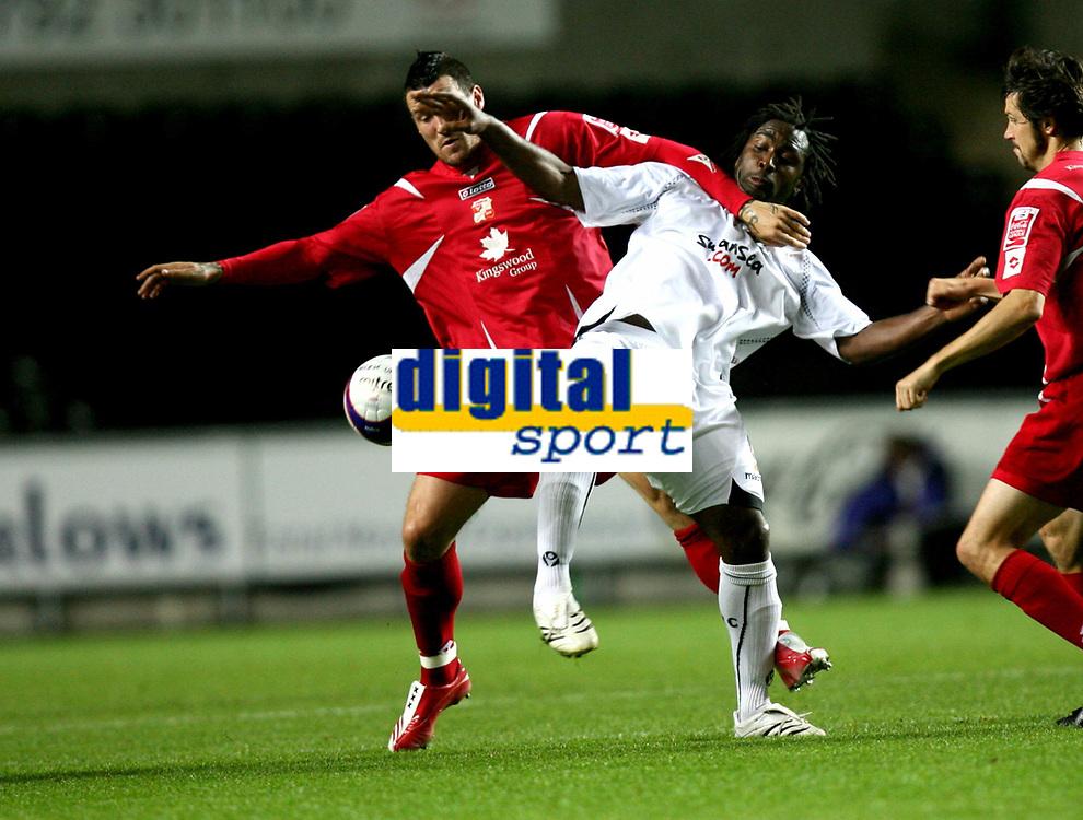 Photo: James Davies.<br />Swansea City v Swindon Town. Coca Cola League 1. 02/10/2007. <br />Swindon`s Lee Peacock battles with Jason Scotland.