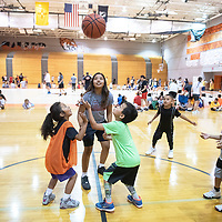 Kamryn Yazzie, center, tosses the ball into the air for Alaena Dunlap, 6, left, and Yandiin Houston Jr., 8, right, for a jump ball as they begin a scrimmage Monday, June 3 at the Bengal Basketball Kids Camp at Gallup High School.