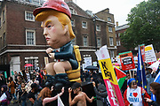 Thousands turned out to protest against US President Trumps visit to London, June 4th 2019, London, United Kingdom. A giant Trump robot  sitting on a toilet whilest tweeting, an art work by American artist Don Lessem.