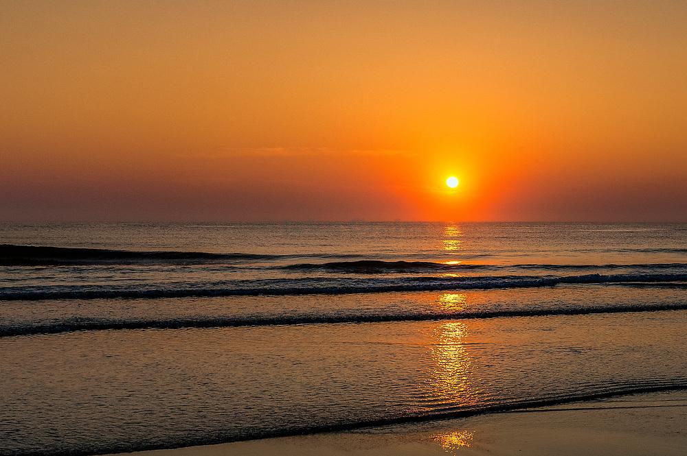 Ocean sunrise, Nauset Beach, Cape Cod, Massachusetts, USA.