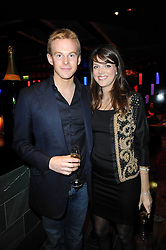 GENEVIEVE CHAPMAN and JAMES OSBORNE at the Tatler Little Black Book Party held at Chinawhite, 4 Winsley Street, London on 20th November 2009.
