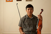 Victor with his fiddle. He's taking lessons, and wants to learn to play the traditional Nahuatl songs his maternal uncle plays.