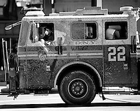 13 September 2001: Fireman wears a mask while driving engine 22 with messages written in ashes days after the Terrorist attack on the America's.  Lower Manhattan, NY. Area surrounding ground zero where the World Trade Centers WTC once stood only hours after they fell to the ground in New York.  Islamic terrorist Osama bin Laden declares The Jihad or Holy War against The United States of America on September 11, 2001. Headline news photos available for editorial use.