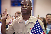 July 4, 2008 -- Phoenix, AZ: KERBY TEKEMAQUE, a member of the US Marines originally from Haiti, takes the oath of citizenship at a naturalization ceremony in Phoenix, AZ, Friday. He is shipping out with his unit to Iraq next week and said he wanted to deploy as a US citizen. About 300 people from 41 countries were naturalized as US citizens at South Mountain Community College, in Phoenix, AZ, Friday. It was the 20th year the college has hosted the Fiesta of Independence. More than 5,000 people have become naturalized US citizens at the Fiesta of Independence. More than 5,000 people have become naturalized US citizens at the Fiesta of Independence. The largest number of new citizens, 158, came from Mexico. There were also large numbers of new citizens from the Philippines, Bosnia-Herzegovnia and India.  Photo by Jack Kurtz / ZUMA Press