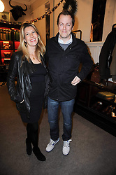 TOM & SARA PARKER BOWLES at a party to celebrate the publication of Dogs in Vogue by Judith Watt held at James Purdey & Sons, Audley House, 57-58 South Audley Street, London W1 on 3rd December 2009.