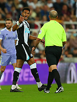 NEWCASTLE UPON TYNE, ENGLAND - SEPTEMBER 17: Joelinton of Newcastle United shouts at the referee, Mike Dean, during the Premier League match between Newcastle United and Leeds United at St. James Park on September 17, 2021 in Newcastle upon Tyne, England. (Photo by MB Media)