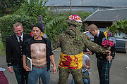 WOJTEK GASIOROWSKI; BURRYMAN ANDREW TAYLOR, Burry Man, Queensferry. 12 August 2016 Alocal man is covered from head to ankles in burrs and paraded a 7 mile route around the town visiting the community.<br /> Tradition holds that he will bring good luck to the town if they give him whisky and money,  This year he wore a Scottish flag.