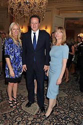 Left to right, RUTH SULLIVAN, The Prime Minister DAVID CAMERON and ROSIE NIXON at a reception for Women in Media hosted by the Prime Minister David Cameron at 10 Downing Street, London on16th May 2013.