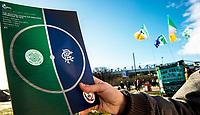 01/02/15 SCOTTISH LEAGUE CUP SEMI-FINAL<br /> CELTIC v RANGERS<br /> HAMPDEN - GLASGOW<br /> A fan shows off their match programme