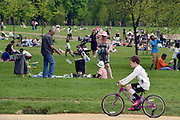 © Licensed to London News Pictures. 06/05/2013. London, UK People relax in Kensington Palace Gardens. People enjoy the sunny bank holiday Monday weather today 6th May 2013 in London's Royal Parks. Photo credit : Stephen Simpson/LNP