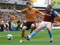 Photo: Steve Bond/Richard Lane Photography. Wolverhampton Wanderers v Aston Villa. Barclays Premiership 2009/10. 24/10/2009. Kevin Doyle (L) is tackled by Richard Dunne