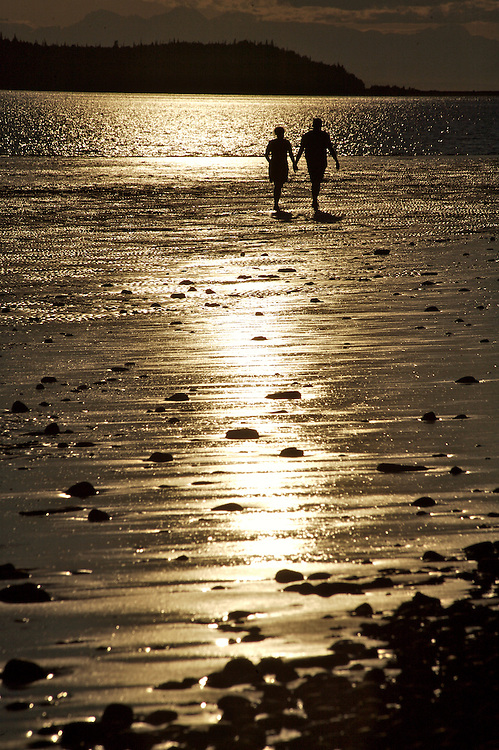 Couple on beach, Anchorage, Alaska