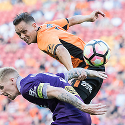 BRISBANE, AUSTRALIA - OCTOBER 30: Jade North of the roar and Andy Keogh of the Glory compete for the ball during the round 4 Hyundai A-League match between the Brisbane Roar and Perth Glory at Suncorp Stadium on October 30, 2016 in Brisbane, Australia. (Photo by Patrick Kearney/Brisbane Roar)