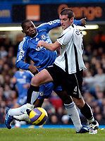 Photo: Ed Godden.<br />Chelsea v Fulham. The Barclays Premiership. 30/12/2006.<br />Chelsea's Geremi (L), is fought off the ball by Frank Queudrue.