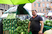 Business is good for the watermelon man on a hot summer afternoon in St. Petersburg, Russia.