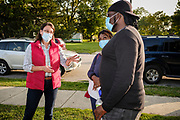 18 SEPTEMBER 2020 - FT. DODGE, IOWA: THERESA GREENFIELD (left, red vest) talks to Iowa voters in H.C. Meriwether Park in Ft. Dodge. Greenfield, the Democratic candidate for US Senate, visited a National Black Voter Day voter registration event in Ft. Dodge, about 100 miles north of Des Moines. Greenfield is running against incumbent US Senator Joni Ernst, a Republican.      PHOTO BY JACK KURTZ