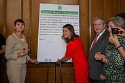 Caroline Lucas, Green Party and Jo Swinson, Leader of the Liberal Democrats sign a declaration at a meeting of a cross-party group of MPs at Church House, London, United Kingdom. The declaration states they will continue to meet as an alternative House of Commons if Prime Minister Boris Johnson temporarily shuts down Parliament to get a no-deal Brexit through.