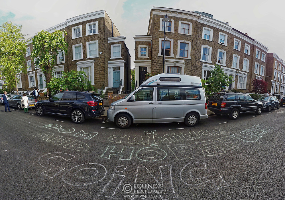 """London, United Kingdom - 24 May 2020<br /> Protests outside Dominic Cummings home. The scenes unfolding today at Dominic Cummings home in North London. Boris Johnsons political advisor spent the day in discussions with the Prime Minister after accusations of breaking the Corona virus lockdown. Neighbours and passers-by protested and shouted """"hypocrite"""", """"resign"""" and """"shame on you"""" when he returned to his house. London, England, UK.<br /> **VIDEO AVAILABLE**<br /> (photo by: EQUINOXFEATURES.COM)<br /> Picture Data:<br /> Photographer: Equinox Features<br /> Copyright: ©2020 Equinox Licensing Ltd. +443700 780000<br /> Contact: Equinox Features<br /> Date Taken: 20200524<br /> Time Taken: 180109<br /> www.newspics.com"""