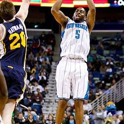 December 17, 2010; New Orleans, LA, USA; New Orleans Hornets guard Marcus Thornton (5) shoots over Utah Jazz small forward Gordon Hayward (20) during the second half at the New Orleans Arena.  The Hornets defeated the Jazz 100-71. Mandatory Credit: Derick E. Hingle