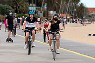 Cyclists are seen riding along St Kilda Beach during COVID-19 in Melbourne, Australia. Premier Daniel Andrews comes down hard on Victorians breaching COVID 19 restrictions, threatening to close beaches if locals continue to flout the rules. This comes as Victoria sees single digit new cases. (Photo by Dave Hewison/Speed Media)