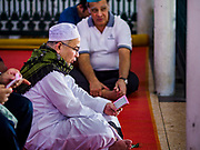 01 SEPTEMBER 2017 - BANGKOK, THAILAND: Men pray during the celebration of Eid al-Adha at Haroon Mosque in Bangkok. Eid al-Adha is also called the Feast of Sacrifice, the Greater Eid or Baqar-Eid. It honours the willingness of Abraham to sacrifice his son. Goats, sheep and cows are sacrificed in a ritualistic manner after services in the mosque. The meat from the sacrificed animal is supposed to be divided into three parts. The family retains one third of the share; another third is given to relatives, friends and neighbors; and the remaining third is given to the poor and needy.     PHOTO BY JACK KURTZ