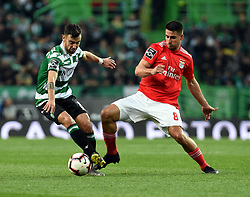 LISBON, Feb. 4, 2019  Bruno Fernandes (L) of Sporting vies with Gabriel of Benfica during the Portuguese League soccer match between SL Benfica and Sporting CP in Lisbon, Portugal, Feb. 3, 2019. Benfica won 4-2. (Credit Image: © Xinhua via ZUMA Wire)