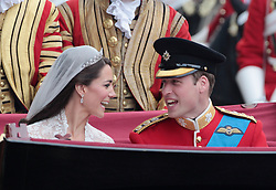 Their Royal Highnesses Prince William, Duke of Cambridge and Catherine, Duchess of Cambridge make the journey by carriage procession to Buckingham Palace past crowds of spectators following their marriage at Westminster Abbey. PRESS ASSOCIATION Photo. Picture date: Friday April 29, 2011. See PA story WEDDING . Photo credit should read: Matt Cardy/PA Wire
