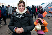 France. Refugees. Calais. So-called Jungle camp where Doctors of the World have a clinic. Nais and her daughter Karla, from Iraq, with the blanket they have been given