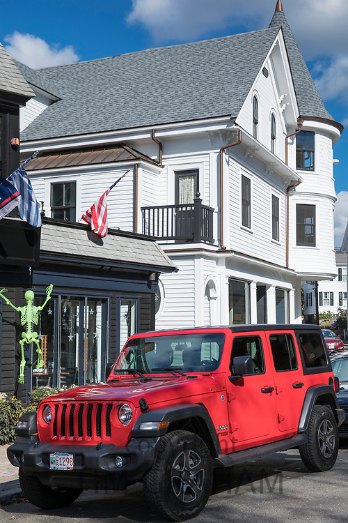 American red Jeep parked by Bar and Restaurant at Manchester-by-the-Sea. Massachusetts, USA