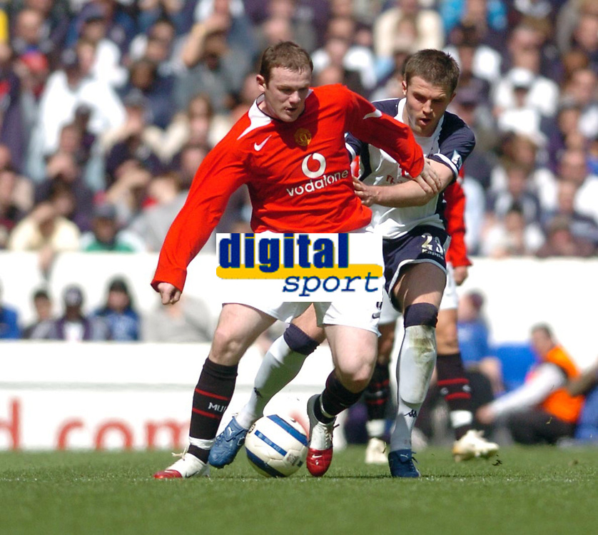Photo: Leigh Quinnell.<br /> Tottenham Hotspur v Manchester United. The Barclays Premiership. 17/04/2006. Tottenhams Michael Carrick can't keep hold of Man Utds' Wayne Rooney.