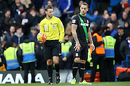 Referee Mark Clattenburg looks at Marko Arnautovic of Stoke City. Barclays Premier league match, Chelsea v Stoke city at Stamford Bridge in London on Saturday 5th March 2016.<br /> pic by John Patrick Fletcher, Andrew Orchard sports photography.