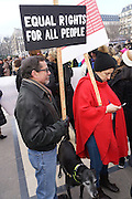 January, 21st, 2017 - Paris, Ile-de-France, France: Protesters with 'Equal Rights for All People' placard. Thousands of protesters in Paris join anti-Trump Women's March around the world.