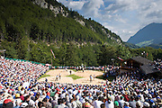 29 JULY 2007 -- BRUNIG, OBWALDNER, SWITZERLAND: Overview of the Brunig Schwinget, a wrestling tournament in Brunig, in the canton of Obwaldner, Switzerland. Schwingets are Swiss style wrestling tournaments held throughout Switzerland. They are usually held outdoors in Alpine mountain passes. Wrestlers wear special canvas pants over their regular clothes. They grip each others pants and wrestle on bed of sawdust. The Schwinget in Brunig is one of the most popular in Switzerland with over 6,000 spectators and more than 120 wrestlers. There is Swiss Alpenhorn blowing, flag throwing and yodeling at the Schwinget.  Photo by Jack Kurtz