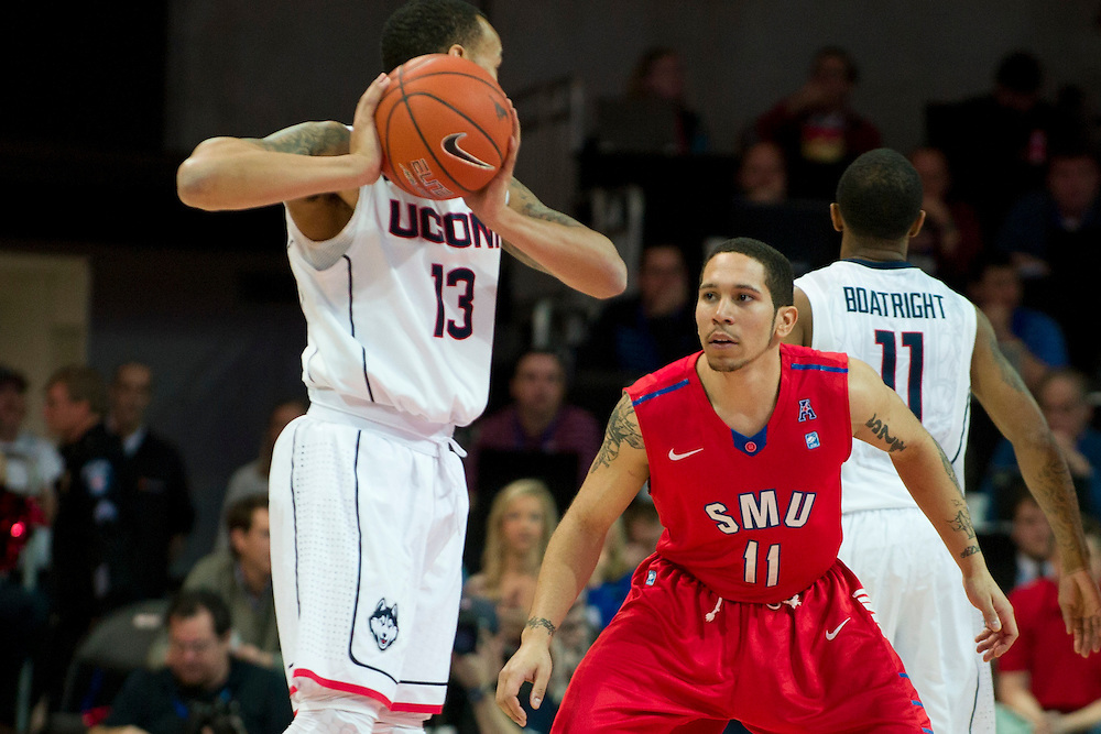 DALLAS, TX - JANUARY 4: Nic Moore #11 of the SMU Mustangs defends Shabazz Napier #13 of the Connecticut Huskies on January 4, 2014 at Moody Coliseum in Dallas, Texas.  (Photo by Cooper Neill) *** Local Caption *** Nic Moore
