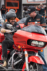 Harley-Davidson's Steve Hill explains the features of the 2017 Road Glide CVO to Fernando Valentin of FL (originally from Uraguay) before his test ride during Daytona Beach Bike Week. FL. USA. Sunday March 12, 2017. Photography ©2017 Michael Lichter.