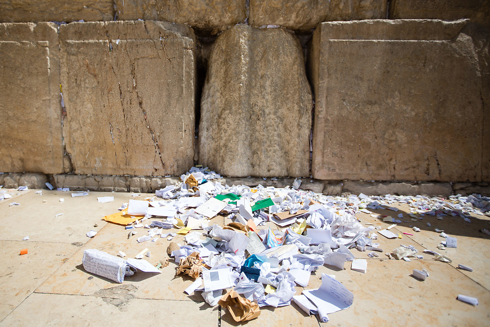 Notes containing prayers and messages which were left by visitors, are seen on the the floor after being removed by workers from the cracks between the stones of the Western Wall, Judaism's holiest prayer site, in the Old City of Jerusalem, Israel, on September 17, 2017. The clean-up which takes place ahead of the upcoming Jewish New Year Holiday, clears the wall's crevices and frees up space for more notes that people of all faiths slip between its stones, believing that requests deposited at the site are more likely to be heard by God.
