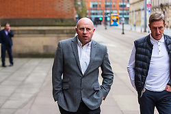 © Licensed to London News Pictures . 23/03/2021. Manchester , UK . Former Manchester United and England footballer RONNIE WALLWORK (centre) and DAVID GARNER (right) arrive at Minshull Street Crown Court . Wallwork and Garner face prison after previously pleading guilty to inflicting grievous bodily harm upon a man during an incident at a bar on 22nd December 2019 . Photo credit : Joel Goodman/LNP